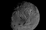 Giant Asteroid Vesta Likely Cold and Dark Enough for Ice